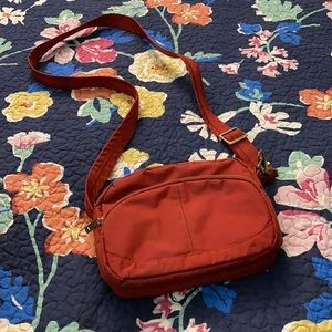 Travelon red sling purse